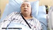医生被打伤住院 穿病号服抢救病人