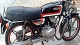 1982年的Kawasaki KH100,前轮碟刹,排气筒的机油才是最大的亮点