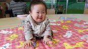 唐氏综合症宝宝:12个月大去体检,笑起来的样子特别可爱