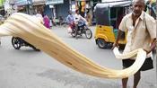 神奇好玩的街头手工糖制作:糖稀能拽1米多长,现做现卖印度超火