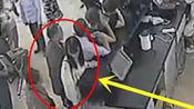 年轻女子正在柜台排队办理业务 监控恰巧拍下身后男子这一幕