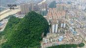 广西贺州市市中心繁华地段有座山,你知道为什么不推掉建楼房吗?