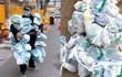 武汉社区网格员全身挂满药袋,排队12小时为患者代购买药