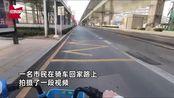 武汉小区禁止居民进出第1天:市民骑车穿越街道,下午3点人迹罕至