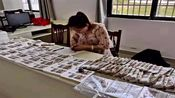 合肥:警方端掉家族式假币工厂 父子俩加女婿造假21万余元